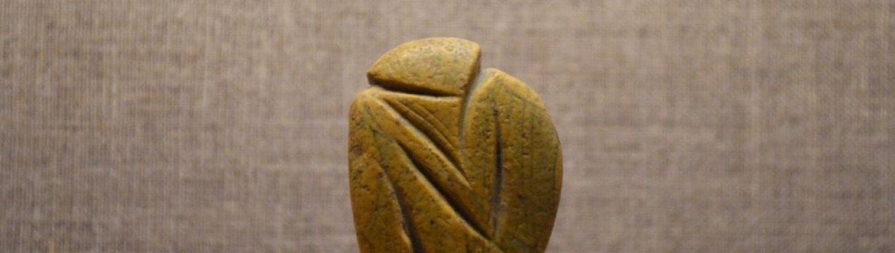 Seated sculptured pebble